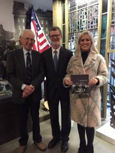 Ernie (left), pictured with the US Consul General Daniel Lawton (middle) at the launch of his book in December 2015.