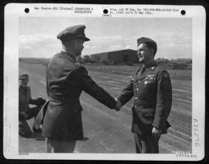 Lt. Colonel RW Crisp presents the Air Medal to Staff Sergeant George B Boyte, a gunner on a B24 Liberator, from Lewiston Idaho