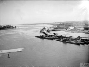 SURRENDERED U-BOATS GATHER IN NORTH IRELAND PORT. 24 AND 25 MAY 1945, LISAHALLY, NEAR LONDONDERRY. PART OF THE FLEET OF SURRENDERED U-BOATS MOORED AT LISAHALLY, UNDER ARMED GUARD. TWENTY SEVEN WERE THERE ON 24 MAY 1945. (A 28894) General view of Lisahally, showing U-boat berthing places. Copyright: © IWM. Original Source: http://www.iwm.org.uk/collections/item/object/205160207
